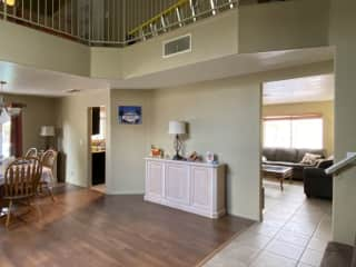 Sharp right to take the stairs. Living room is on the far right, dining table on the left. The kitchen can be accessed from the both sides.