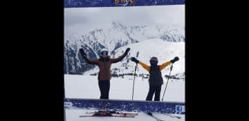 Housitters skiing together.