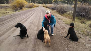 JoAnn in Creede, Colorado with Ivy, Lily, Gracie and Zoe (RIP)