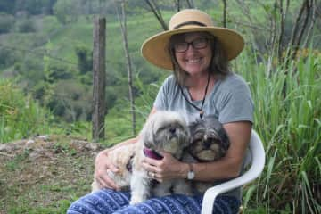 Snuggling with Sheba and Milo in the fresh mountain air of Panama.