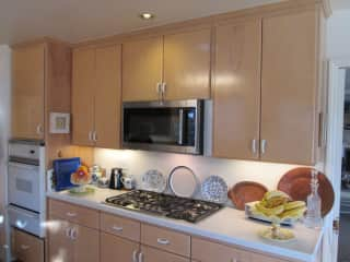 View of appliances in kitchen on interior wall.