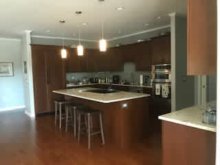Kitchen, cook-top is located on the island.