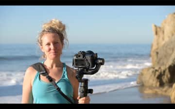 Filming a sunrise session at the ocean