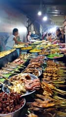 Trying exotic food in Laos.