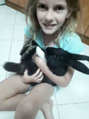 Poppy with our pet rabbit Twilight. He would often fall asleep in her arms