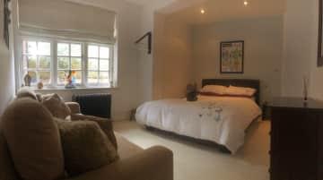 Bedroom overlooking garden with en-suite shower room and toilet.