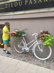 Helen in France enjoying the flowers and admiring the craftsmanship