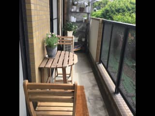 Little balcony, bistro table, and container garden.