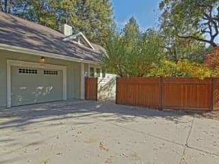 Front entry, space for two cars in front of garage. There's also ample parking down the hill by the city park.