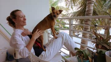 This is me w Bogie in Miami. His parents moved to India, so he lives with me now <3
