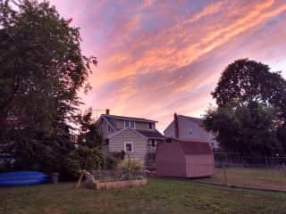 Backyard garden and kayaks under a beautiful sunset