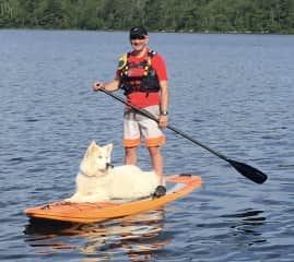 Spirit loves to go on the paddle board