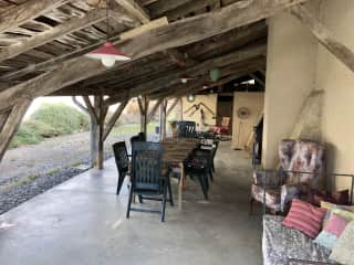 The back terrace is perfect for evening meals when the weather is warm. It is equipped with a cooker, a gas BBQ and a plancha and has access to the kitchen through a utility room.