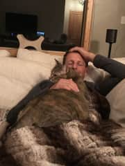 Jeremy getting snugs with Luna, a housesitting cat