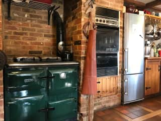 Kitchen with range cooker and conventional oven