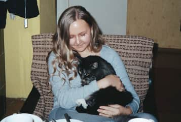 With my family cat who is now 13 years old.