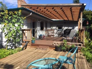 Large covered back deck; yard is fully fenced