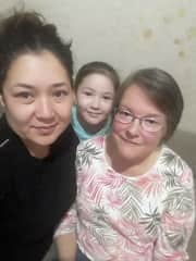 I love to travel. Here I am with my son's sister and her daughter in Akkol, Kazakhstan. My husband and I adopted our four children from an orphanage in that village. My son's sister had already been adopted before my son was born.
