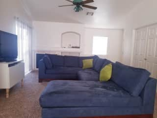 """Living area with 60"""" TV PS4 with Netflix, Disney+, Prime, and HBO max ready to go"""