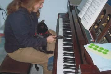 Playing a tune with Visby at the piano.