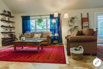 The main living room is warm and cozy, and we also have an upstairs living area. Both have TVs with streaming capabilities, and there are also plenty of games.