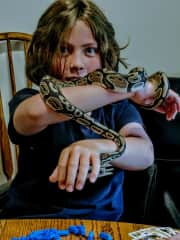 This is my younger son helping me take care of a snake