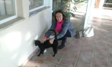 Me and 'Blackie'...one of the cats belonging to one of