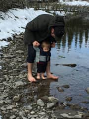 Jordan and Saph immersing their feet in cold water for immune system boost.