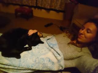 Watching Friends with Gobelino sleeping sweetly.