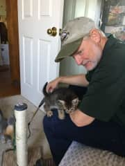 Margaret's husband Mark helping to socialize our fostercare kittens.