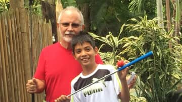 Ray and son playing mini golf in Honolulu!