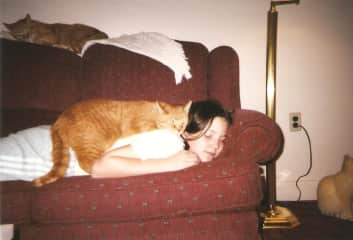 Me as a teenager with my first cat Speedy.