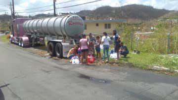Our Neighbors coming together for a water break,sure beats the office water cooler