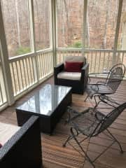Screened in back porch with a forest view. A great place for a coffee on a crisp morning. Adirondack chairs are available by the fire pit in the backyard, or sit on the front porch!