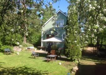 Our former house, garden in summer