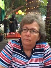 Jeannine dining in Playa del Carmen, Mexico, unaware of a gorilla.