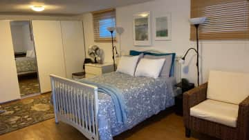 Spacious guest bedroom with TV, Apple TV and en suite bathroom.