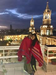 Jetta and Vanessa at the main square with a rooftop view in Arequipa, Peru.