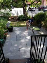 Back patio. Now has table with umbrella. Collapsible clothesline also here.