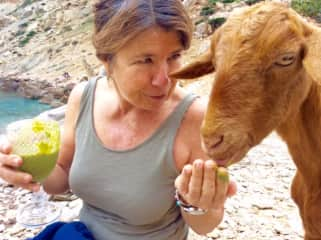 Sharing my green smoothie with a wild goat at Cala Boquer, Mallorca.  She loved it!