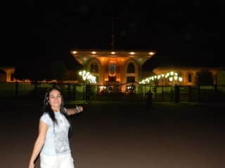 I love to travel! Here I am posing with a palace in the country of Oman.
