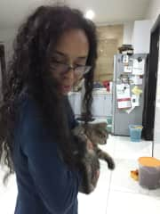 Catherine with Pumpkin, a rescued kitten