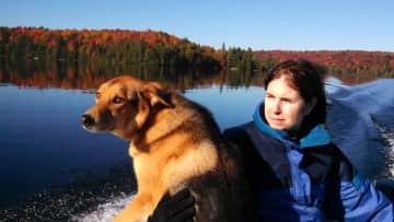 Kim and Zip boating to the cottage