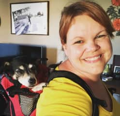 Zoe and I with her new backpack. She's an older dog so sometimes she can't make it on the long hikes. We're excited because this backpack is very comfortable for her.