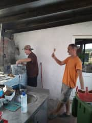 Ron teaching John how to tile, although John seems have a lot to say about that