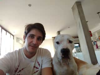 Tomi with Blanca, his best friend's dog.