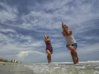 My daughter and I doing yoga at the beach