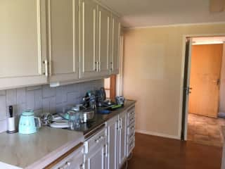 A new kitchen will go in during the fall but there is nothing wrong with the current 80s style. But it does look scruffy and discoloured as it's old