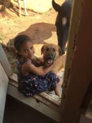 Noa, our youngest, and our dog Happy