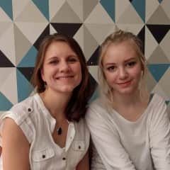 with my daughter in a cafe in Paris
